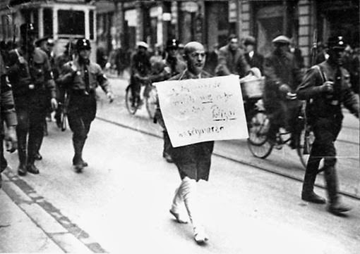 This is a photo shot on the streets of Munich, Germany on 10th March 1933; just six weeks after Hitler came to power. The picture, published across the world and later in many history books, was a chilling portent of the hellish events that were about to consume Germany and much of the rest of the planet. Many have seen this photo, but few know the background behind it.